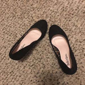 Never worn black suede wedge heels